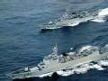 美军P8A近距离拍摄中国052C驱逐舰所欲为何